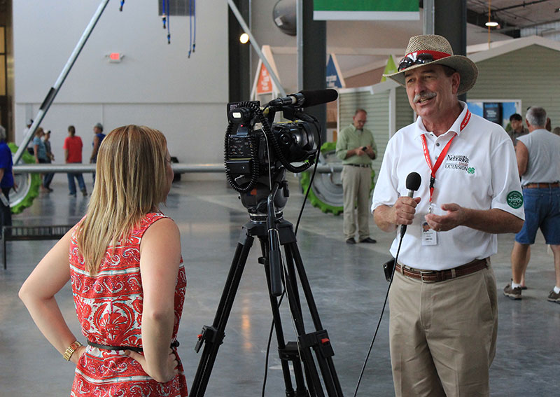 Dr. Chuck Hibberd, Director of Extension, talks with the media on opening day. (Photo: Raising Nebraska)